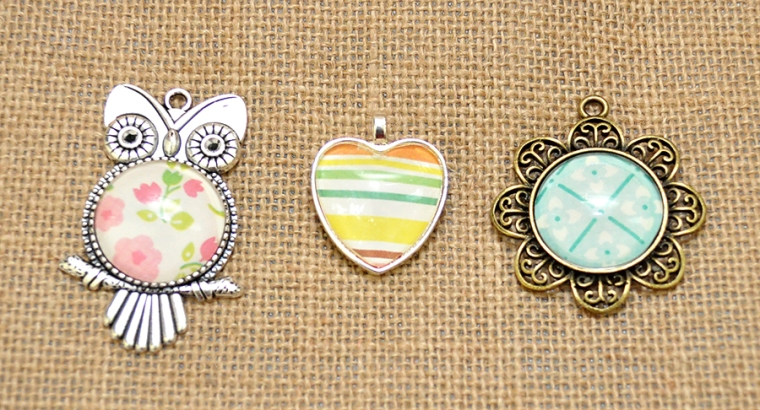 Scrapbook paper pendants. Inexpensive and fun YW Girls Camp craft! or YW gift!